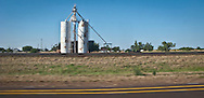 grain elevators in a rural village in west Texas along I-20 and railroad tracks panorama