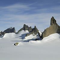 ANTARCTICA, Queen Maud Land.  Fenris Mountains.  L to R: 2455m Mundlanuga, 2650m Holtanna, 2577m Holsttind (sub-peak of Holtanna), 2721m Kinntanna, Stetind, 2931m Ulvetanna.  Sigyn Glacier foreground.