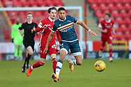 Aberdeen midfielder Scott Wright (25) and Motherwell's Jake Carroll (3) battles for possession, tussles, tackles, challenges, during the Scottish Premiership match between Aberdeen and Motherwell at Pittodrie Stadium, Aberdeen, Scotland on 23 January 2021.