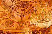 Interior of The National  Palace of Queluz,  Sintra, near Lisbon, Portugal - decorated ceiling and chandeliers