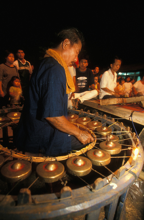 Musicians play their instruments during a traditional Shan theatre performance at Poy Sang Long, the yearly ordination of novice monks in Mae Hong Son, Thailand.