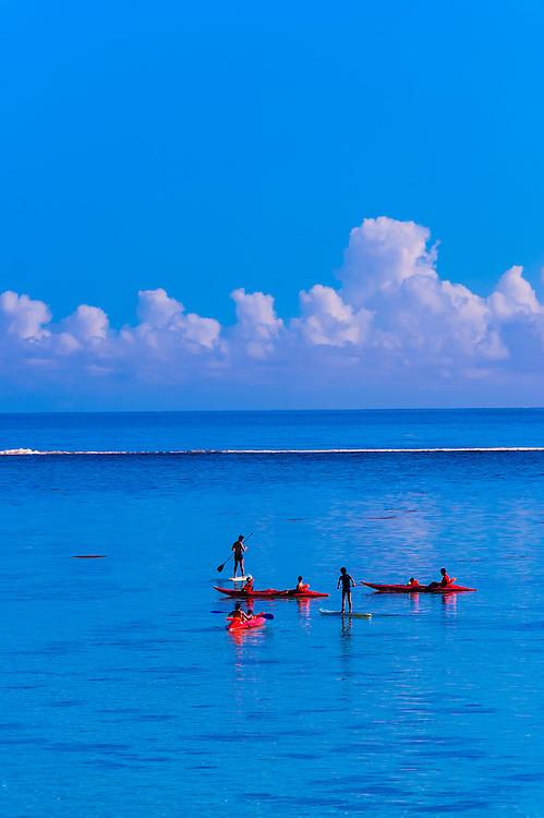 Standup paddleboarding, Hilton Moorea Lagoon Resort, island of Moorea, French Polynesia.