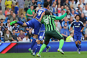 Bayo Akinfenwa of AFC Wimbledon and Sean Morrison (Captain) during the Capital One Cup match between Cardiff City and AFC Wimbledon at the Cardiff City Stadium, Cardiff, Wales on 11 August 2015. Photo by Stuart Butcher.