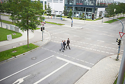 From above three businessmen crossing road team