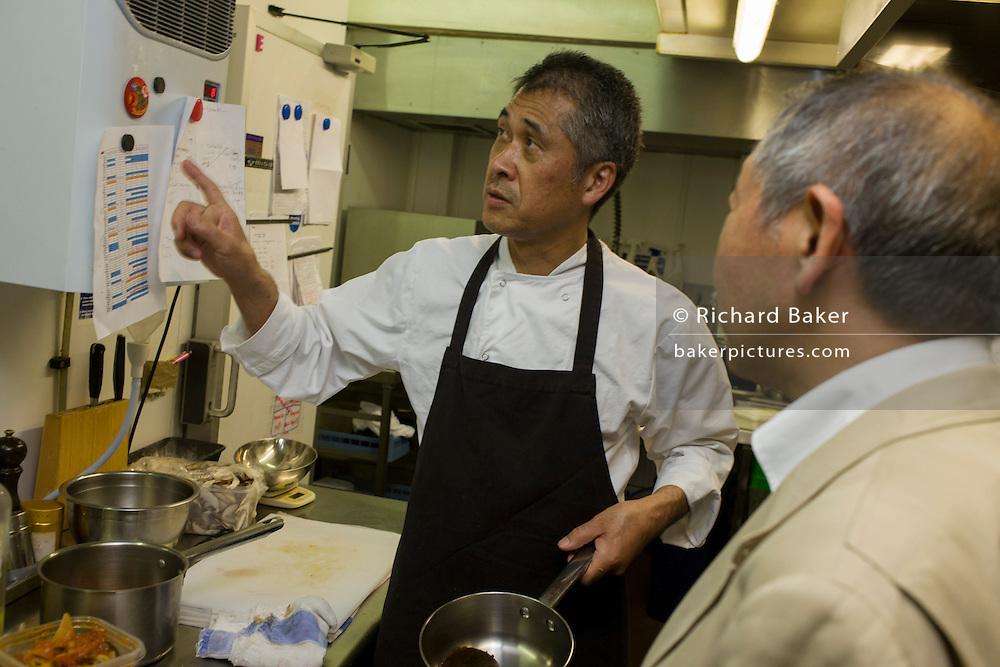 Japanese entrepreneur, Tetsuro Hama with sushi chef and old friend, Kaoru Yamamoto at his 'So' restaurant business, Soho, London.