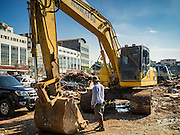 29 SEPTEMBER 2015 - BANGKOK, THAILAND:  Heavy equipment at the redevelopment of Bang Chak Market. The Bang Chak Market serves the community around Sois 91-97 on Sukhumvit Road in the Bangkok suburbs. About half of the market has been torn down, vendors in the remaining part of the market said they expect to be evicted by the end of the year. The old market, and many of the small working class shophouses and apartments near the market are being being torn down. People who live in the area said condominiums are being built on the land.       PHOTO BY JACK KURTZ