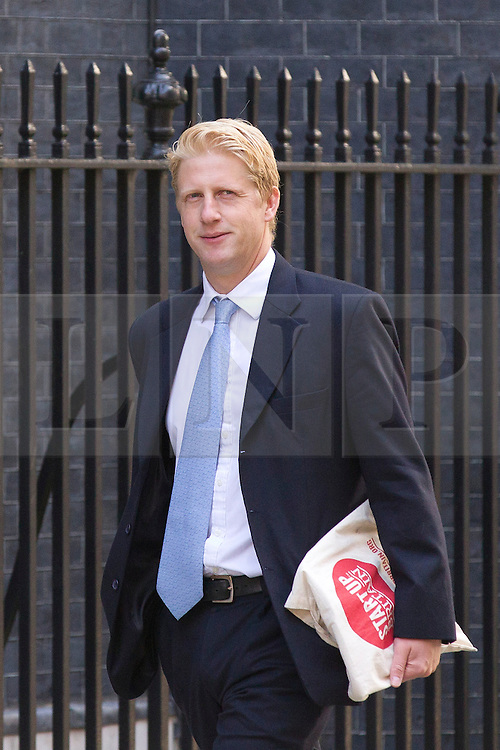 "© Licensed to London News Pictures. 29/08/2013. London, UK. Jo Johnson, brother of London Mayor Boris Johnson and the head of Head of the Number 10 Policy Unit arrives for a meeting of the British cabinet on Downing Street in London today (29/08/2013) as a recalled British Parliament prepares to debate the possibility of ""direct"" military action over recent reports an alleged chemical weapons attack in Syria. Photo credit: Matt Cetti-Roberts/LNP"