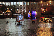 Great Chicago Fire Festival on Saturday, October 4, 2014. Projection boats and kayakers float around house near Veteran's Memorial.