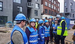 © Licensed to London News Pictures. 22/11/2019. Sheffield, UK. Liberal Democrat Leader Jo Swinson, meets with staff as she visits the Little Kelham eco house building project during a General Election campaign trail stop in Sheffield. Britain will go to the polls on December 12, 2019 to vote in a pre-Christmas general election. Photo credit: Ioannis Alexopoulos /LNP