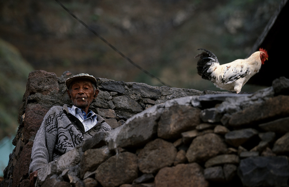 Aon old man relaxes in Fontainhas village in the north coast of Santo Antao which is an extraordinary scenery. To go there it takes one hour, because distances are time measured in Santo Antao.