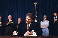 President Roanld Reagan signs the International Human Rights Bill on December 10, 1984<br />Photograph by Dennis Brack