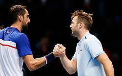 Jack Sock (right) shakes hands with Marin Cilic after defeating him during day three of the NITTO ATP World Tour Finals at the O2 Arena, London.