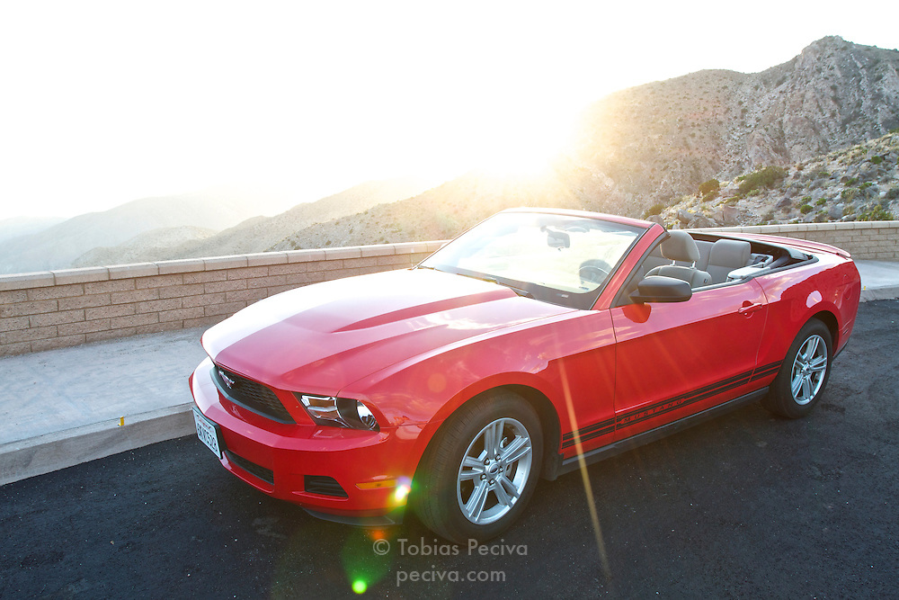 Backlit Ford Mustang convertible parked in Joshua Tree National Park, California.