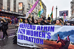 © Licensed to London News Pictures. 27/01/2018. LONDON, UK.  Protesters in Whitehall hold up signs as thousands of Kurdish people march from outside the BBC's Headquarters in Portland Place to Downing Street to protest against Turkey's military invasion of the city of Afrin in Northern Syria, a predominantly Kurdish city.  Protesters called for the British public to show solidarity with the people of Afrin and for the UK to demand that Turkey pull back its forces.  Photo credit: Stephen Chung/LNP
