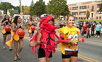 Cassy Kimball as the crab and Alisha Martin as Spongebob followed by all the fishes in the Sophomore class march in the LHS Homecoming Parade Friday evening.  (Karen Bobotas/for the Laconia Daily Sun)