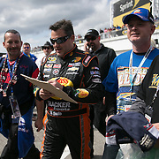 Driver Tony Stewart signs autographs for fans after the last practice session for the 57th Annual NASCAR Daytona 500 race at Daytona International Speedway on Saturday, February 21, 2015 in Daytona Beach, Florida.  (AP Photo/Alex Menendez)