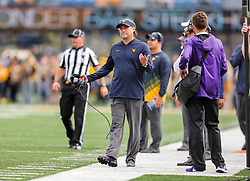 Sep 22, 2018; Morgantown, WV, USA; West Virginia Mountaineers head coach Dana Holgorsen walks along the sidelines during the first quarter against the Kansas State Wildcats at Mountaineer Field at Milan Puskar Stadium. Mandatory Credit: Ben Queen-USA TODAY Sports