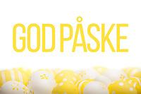 Ferdigdesign med påskehilsenen «God påske» over en seng av gule og hvite påskeegg i bunn.