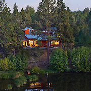 River front modern residence surrounded by nature and beauty