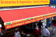 Groceries, vegetables from Afro Caribbean and Latin countries and including Halal meats, are advertised on the awning of a high street retailer in south London, on 13th September 2021, in London, England. (Photo by Richard Baker / In Pictures via Getty Images)