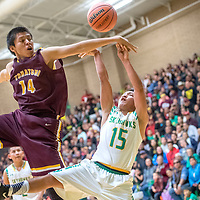 Tohatchi Cougar Austin Haley (14), left, contests a fade-away jumper from Newcomb Skyhawk Deontay Begay (15) in the boys District 1-3A championship at Newcomb High School Friday.