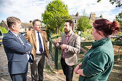 Pictured: Keith Brown,  George Elliis, Josiah Lockhart and Maia Gordon<br /> <br /> Cabinet Secretary for Economy, Jobs & Fair Work Keith Brown visited Gorgie City Farm today  to mark their accreditation as the 800th Living Wage employer in Scotland. Mr Brown met Josiah Lockhart, CEO and undertook a short tour of the farm, celebrating their accreditation and promoting the Living Wage more generally. The Scottish Government has set a target of reaching 1,000 Scottish-based Living Wage Accredited Employers by autumn 2017. While at the farm Mr Brown met Maia Gordon, Kirsty McGoff (17) and Zoe White (18), who have benefited from the living wage, and George Ellis, chair of the farm's board of directors<br /> Ger Harley   EEm 18 May 2017