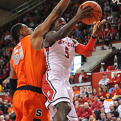 Rutgers Scarlet Knights guard Eli Carter (5) tries for a layup as Syracuse Orange center Fab Melo (51) makes contact during second half NCAA Big East basketball action between #2 Syracuse and Rutgers at the Louis Brown Athletic Center. Syracuse defeated Rutgers 74-64.