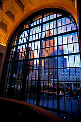 Stock photo of the Houston Texas skyline viewed through a window of the Wortham Center