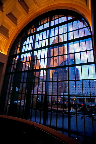 Stock photo of the Houston Texas skyline viewed through a window of the Wortham Center