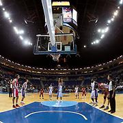 Anadolu Efes's Stratos Perperoglou (C) during their Gloria Cup Basketball Tournament match Anadolu Efes between Crvena Zvezda at Ulker Sports Arena in istanbul Turkey on Friday 26 September 2014. Photo by Aykut AKICI/TURKPIX