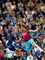 Photo: Alan Crowhurst.<br />Portsmouth v West Ham United. The Barclays Premiership. 14/10/2006. Jonathon Spector of West Ham (R) outjumps Benjani.