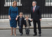 © under license to London News Pictures. 11/05/10. Gordon Brown, his wife Sarah, children John and James pose for the media on Downing Street. British Prime Minister Gordon Brown has resigned his position and David Cameron has become the new British Prime Minister on May 11, 2010. The Conservative and Liberal Democrats are to form a coalition government after five days of negotiation. Photo credit should read Stephen Simpson/LNP