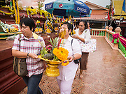 """29 SEPTEMBER 2012 - NAKORN NAYOK, THAILAND:  Thai Buddhists carry offerings to Ganesh during observances of Ganesh Ustav at Wat Utthayan Ganesh, a temple dedicated to Ganesh in Nakorn Nayok, about three hours from Bangkok. Many Thai Buddhists incorporate Hindu elements, including worship of Ganesh into their spiritual life. Ganesha Chaturthi also known as Vinayaka Chaturthi, is the Hindu festival celebrated on the day of the re-birth of Lord Ganesha, the son of Shiva and Parvati. The festival, also known as Ganeshotsav (""""festival of Ganesha"""") is observed in the Hindu calendar month of Bhaadrapada, starting on the the fourth day of the waxing moon. The festival lasts for 10 days, ending on the fourteenth day of the waxing moon. Outside India, it is celebrated widely in Nepal and by Hindus in the United States, Canada, Mauritius, Singapore, Thailand, Cambodia, Burma , Fiji and Trinidad & Tobago.     PHOTO BY JACK KURTZ"""