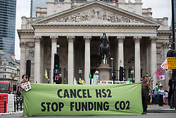 © Licensed to London News Pictures.  27/08/2021. London, UK. Members of Extinction Rebellion hold a demonstration outside the Bank of England in central London. Photo credit: Marcin Nowak/LNP