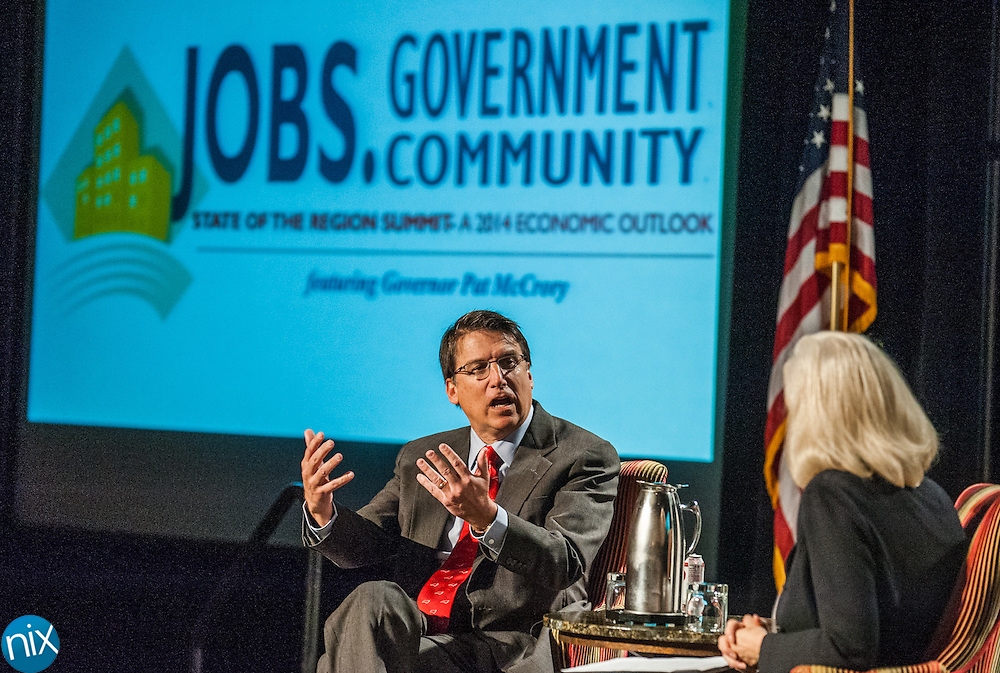 Governor Pat McCrory talks with Lynne Safrit, president of Castle and Cooke, about the economic outlook of 2014 during a State of the Region Summit hosted by the Cabarrus Regional Chamber of Commerce Thursday morning at Embassy Suites in Concord.