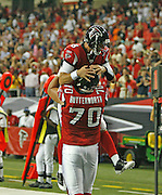 ATLANTA - AUGUST 29:  Offensive lineman Michael Butterworth #70 of the Atlanta Falcons congratulates teammate and quarterback Chris Redman #8 after Redman's game winning touchdown pass during the game against the San Diego Chargers at the Georgia Dome on August 29, 2009 in Atlanta, Georgia.  The Falcons beat the Chargers 27-24.  (Photo by Mike Zarrilli/Getty Images)