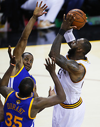June 9, 2017 - Cleveland, OH, USA - The Golden State Warriors' Andre Iguodala and Kevin Durant (35) contest the Cleveland Cavaliers' LeBron James, right, in the fourth quarter during Game 4 of the NBA Finals at Quicken Loans Arena in Cleveland on Friday, June 9, 2017. The Cavs won, 137-116, trimming their series deficit to 3-1. (Credit Image: © Leah Klafczynski/TNS via ZUMA Wire)