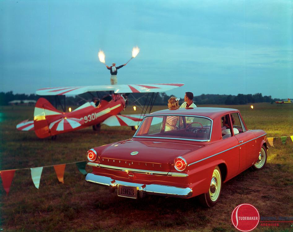 Promotional image of a 1963 Studebaker Lark Regal 2-door sedan.