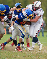 Gilford-Belmont's Dylan Gansert gets locked up by Plymouth's Steven Shute during NHIAA Division II football on Saturday afternoon at the Meadows Field.  (Karen Bobotas/for the Laconia Daily Sun)