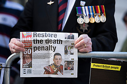 """© London News Pictures. 26/02/2014. London, UK.  A war Veterans holding a page from a newspaper with the words """"Restore the death penalty"""" showing outside the Old Bailey in London where Michael Adebolajo and Michael Adebowale are due to be sentenced for the murder of Fusilier Lee Rigby who was attacked near Woolwich Barracks in south-east London on May 22, 2013. Photo credit: Ben Cawthra/LNP"""