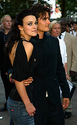 Keira Knightley and Orlando Bloom attending the premiere of 'Pirates of the Caribbean' premiere at London's Odeon Leicester Square.  Half length.