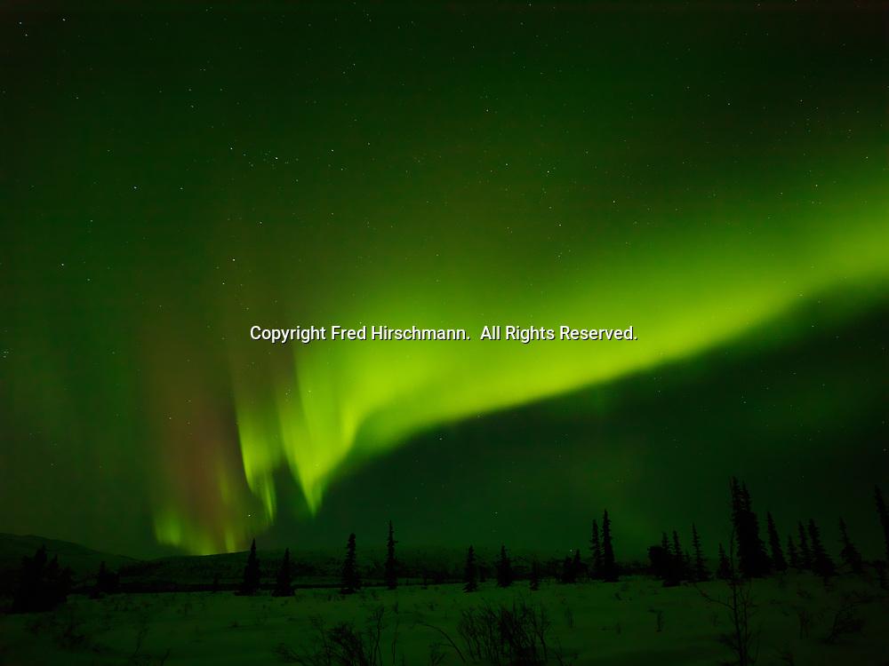 Green and red aurora borealis above Tahneta Pass, night of March 16-17, 2013, Alaska.