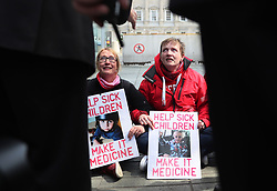 Campaigners for legalising medicinal cannabis Vera Twomey (right) and Sarah Mahoney stage a sit down protest inside the gates of Leinster House, Dublin.