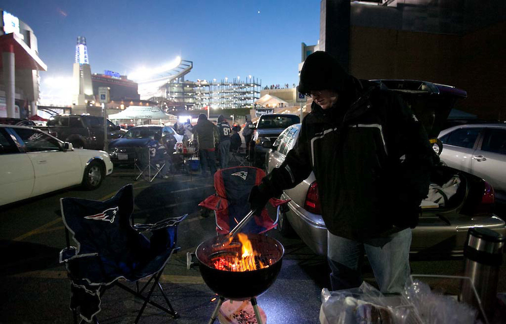 Foxborough, MA 01/14/2012.Ken Korzeniowski of Weymouth grills some sausages while tailgating outside Gillette Stadium before the start of Saturday's AFC Divisional game between the Patriots and the Denver Broncos..Wicked Local Photo by Alex Jones