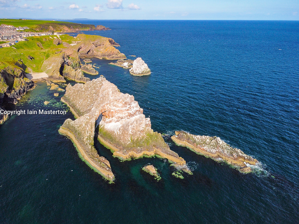 Aerial view from drone of Bow Fiddle Rock at Portknockie on Moray Firth in Moray, Scotland, UK