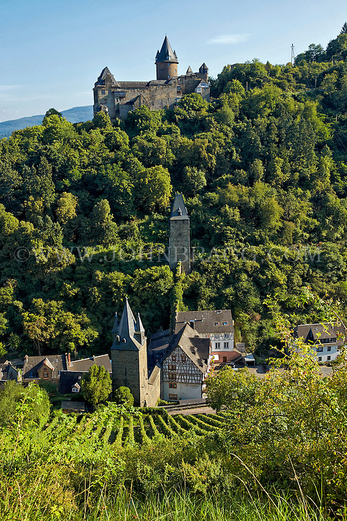 Romantic Rhine view of Stahleck Castle, vineyards, and rolling hills, Bacharach, Germany.