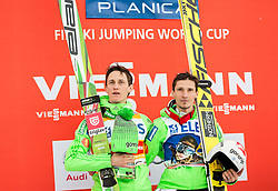 Second placed Peter Prevc (SLO) and winner Robert Kranjec (SLO) listening to the national anthem during trophy ceremony after the Ski Flying Hill Individual Competition at Day 2 of FIS Ski Jumping World Cup Final 2016, on March 18, 2016 in Planica, Slovenia. Photo by Vid Ponikvar / Sportida