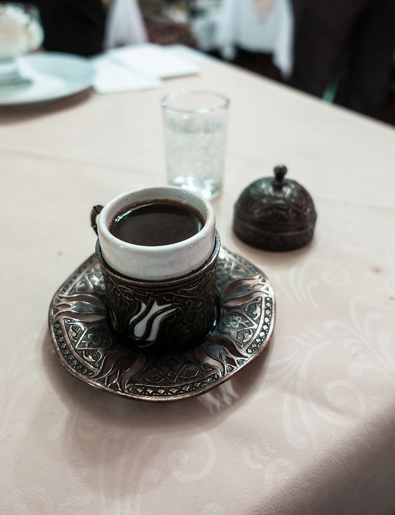 Turkish coffee served in Istanbul, Turkey. Turkish coffee is a brewing method of preparing unfiltered coffee. Roasted and then finely ground coffee beans are stirred into cold water and then boiled in a pot. It is served in a cup where the grounds are allowed to settle. Additional pressure is not involved like in espresso. Turkish Coffee is an Intangible Cultural Heritage of Turkey confirmed by UNESCO.