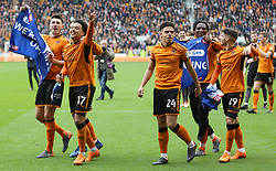 """Wolverhampton Wanderers players celebrate winning promotion to the Premier League after the Sky Bet Championship match at Molineux, Wolverhampton. PRESS ASSOCIATION Photo. Picture date: Sunday April 15, 2018. See PA story SOCCER Wolves. Photo credit should read: Nigel French/PA Wire. RESTRICTIONS: EDITORIAL USE ONLY No use with unauthorised audio, video, data, fixture lists, club/league logos or """"live"""" services. Online in-match use limited to 75 images, no video emulation. No use in betting, games or single club/league/player publications."""