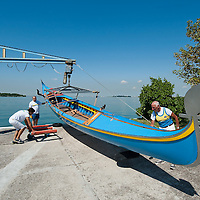 VENICE, ITALY - SEPTEMBER 04:  Members of the Voga Veneta Lido rowing club launch a gongola using a boat crane ahead of Sunday Historic Regata on September 4, 2010 in Venice, Italy. The Historic Regata is the most exciting rowing race on the Gran Canal for the locals and one of the most spectacular ***Agreed Fee's Apply To All Image Use***.Marco Secchi /Xianpix. tel +44 (0) 207 1939846. e-mail ms@msecchi.com .www.marcosecchi.com